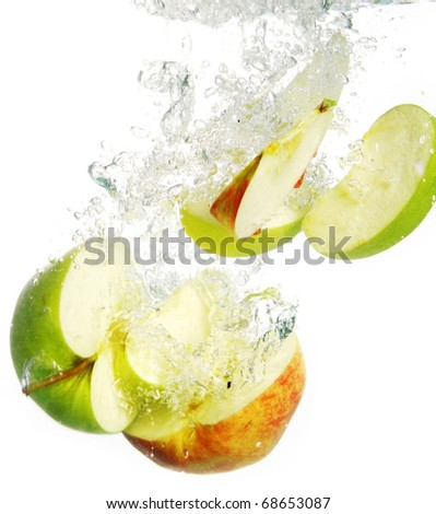 Beautiful and colorful apple falls into water