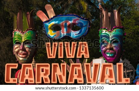 Beautiful and colorful hording at the entrance, decorated with tribal masquerade masks, for the annual festival of Goa, known as Viva Carnaval or Goa Carnaval. #1337135600