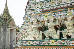 Beautiful and colorful mosaic scupture of monkeys or hanuman or mythical creatures in the buddhist temple in Thailand
