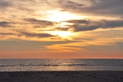 beautiful and colorful sunset on cadiz beach in southern spain