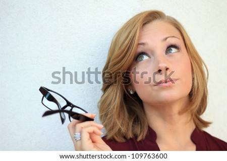 Beautiful and Confident Business Woman Holding Eye Glasses - stock photo
