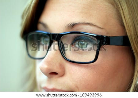 Beautiful and Confident Business Woman Wearing Eye Glasses Side View