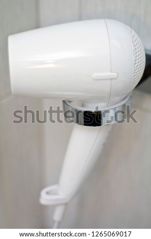 Beautiful and diverse subject. Beautiful and expensive blonde, white electric fke and a hair and body dryer in the bathroom. Stok fotoğraf ©