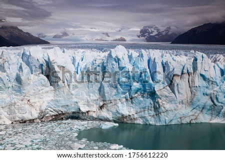 beautiful and dramatic front view of the perito moreno glacier, Argentina. White and blue ice. Climate change, environmental context. travel and tourism context
