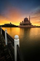 Beautiful and dramatic view of sunrise over the Putrajaya  Mosque located at Putrajaya , Malaysia