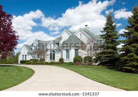 Beautiful and  expensive new home. This house features lots of roof peaks and a circular driveway. Just one of many new home or house photos in my gallery.