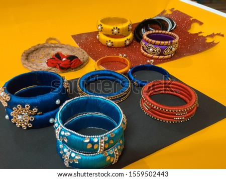 beautiful and fashionable bangles.fashionable crafts and bangles on color background #1559502443
