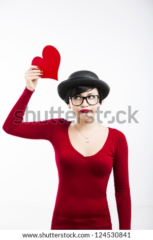 Beautiful  and funny nerd girl, holding a heart over her head, aganist a white background