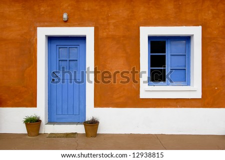 Beautiful and funny orange house with blue doors and windows