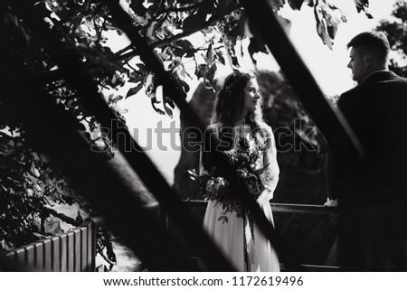Beautiful and happy wedding couple on wedding by the seaside #1172619496