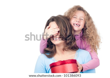 Beautiful and happy young mother and small daughter smiling and laughing. Daughter is giving present to her mother. Isolated on white background.