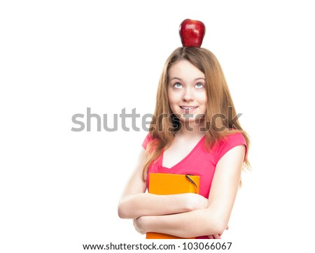 Beautiful and happy young student girl with apple on her head and book in her hands. Looking up and thinking. Isolated on white background.