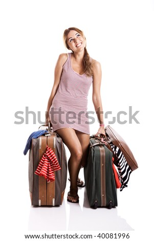 Beautiful and happy young woman carying the baggage with clothes