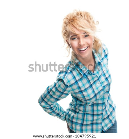 Beautiful and happy young woman standing isolated on white background. Smiling and looking into the camera. Casual style, hands in jeans pockets behind.