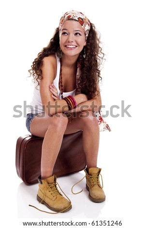 Beautiful and happy young woman with a old suitcase, isolated on white background