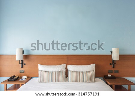 Beautiful and modern bedroom with empty wall for add some text, logo, image, etc.
