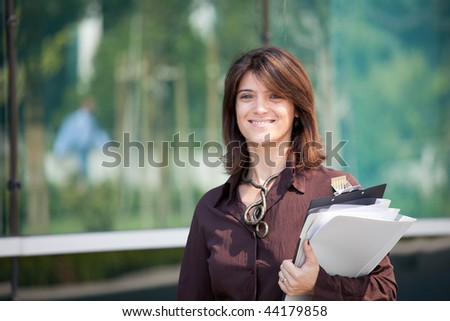 Beautiful and modern businesswoman smiling to you