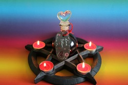 Beautiful and mystical pentagram candle holder for wiccan or witchcraft ritual with love potion