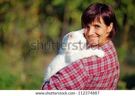 Beautiful and natural adult woman with cat