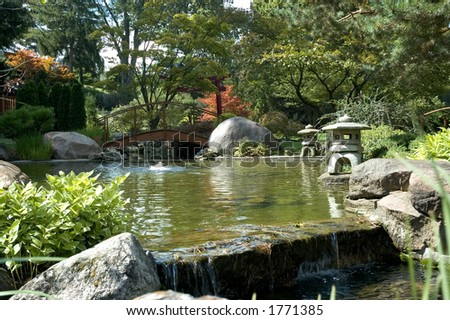 Beautiful And Peaceful Japanese Water Garden Complete With A Bridge Several Small Waterfalls