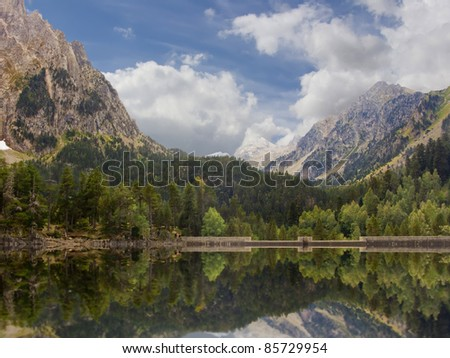 Beautiful and peaceful lake in Vall D'Aran (Pyrenees) surrounded by mountains