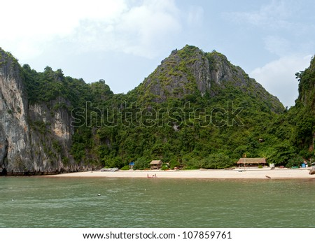 Beautiful and quiet beach with forest and limestone cliffs around in Lan Ha Bay, Vietnam.