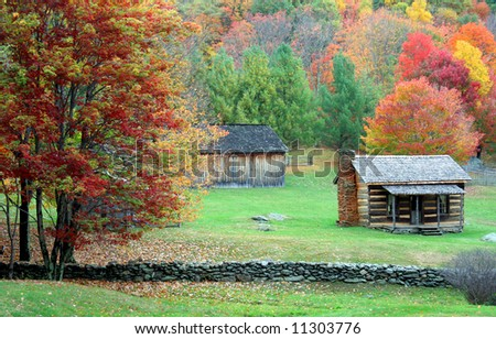 Beautiful and richly colored fall image of a cabin and barn in the mountains.