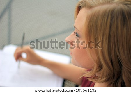 Beautiful and Serious Business Woman Thinking While Writing