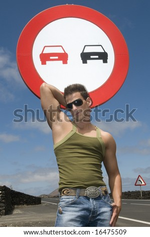 beautiful and sexy man over a trafic signal
