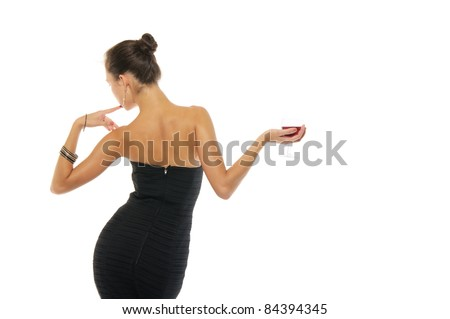 Beautiful and sexy woman in dress with glass of wine isolated on white