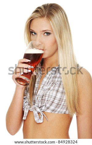 Beautiful and sexy young blond  woman drinking beer, isolated on white