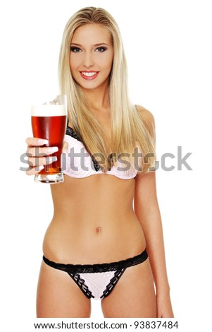 Beautiful and sexy young blond woman holding glass of beer, isolated on white