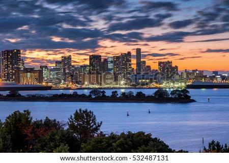 Beautiful and Sweet Twilight evening view of Tokyo Bay, Rainbow bridge and Tokyo Tower landmark from Aqua City, Odaiba, Japan