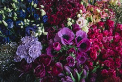 Beautiful and tender blossoming and endless fresh flowers at the florist shop in lavender, pink and purple colors