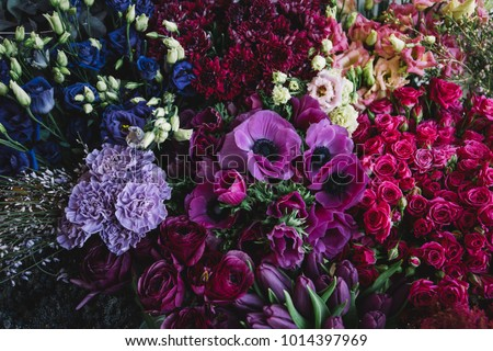 Beautiful and tender blossoming and endless fresh flowers at the florist shop in lavender, pink and purple colors #1014397969
