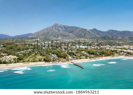 Beautiful and unique aerial perspective of luxury and exclusive area of Marbella, golden mile beach, Puente Romano Bridge. Luxury Clubs, Urbanisation in the most expensive area of Marbella. Mountain Foto stock ©