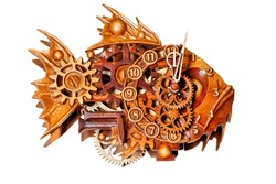Beautiful and unusual wooden wall clock made of wooden parts on the dial in the form of a predatory fish with carved elements. Image isolated on white background.