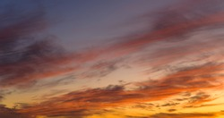 Beautiful and warm colored sunset sky.