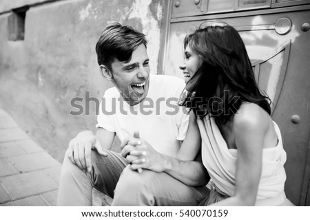 beautiful and young boy and girl sits near doors #540070159