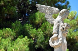 Beautiful angel statue holding a ring bread in its hand. From Avola, Sicily.