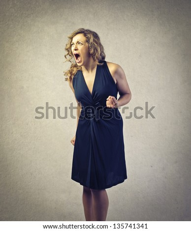 beautiful angry woman screaming