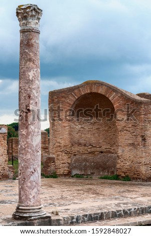 beautiful antique column against the background of ancient ruins in the ancient Italian city of Antica Ostia