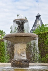 Beautiful antique water fountain in a public park of a European city