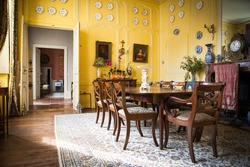 Beautiful antique yellow dining room in luxurious French chateau castle