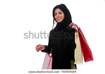 Beautiful arab traditional woman holding shopping bags - stock photo