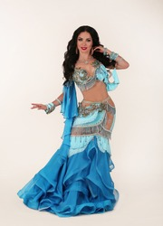 Beautiful Arabian bellydancer dancing portrait isolated. Bellydancer in exotic costume. Belly dancing. Young Turkish girl belly dance artist. Arabic woman with makeup and long curly hair and jewelry