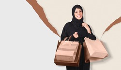 beautiful Arabic woman wearing abaya and hijab with many shopping bags on gray and brown background.
