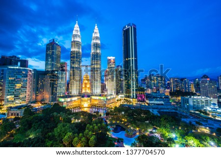 Beautiful architecture building exterior in Kuala Lumpur city in Malaysia for travel at twilight night #1377704570
