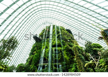 Beautiful architecture building flower dome garden and greenhouse forest landmark of singapore city for travel stock photo