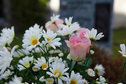 Beautiful artificial outdoor flowers used in a northern European cemetery.